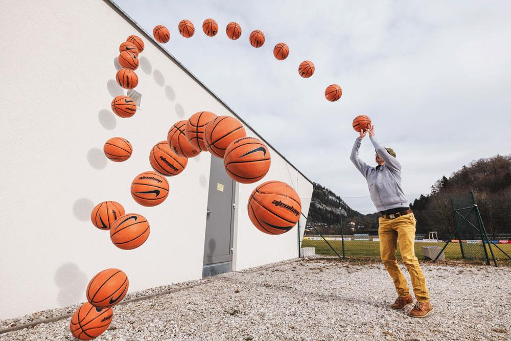Basketball moving through a shot