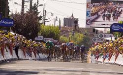 Boonen leads the peloton.