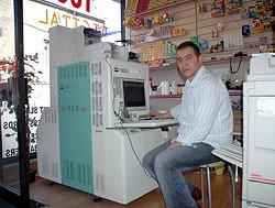 Doli DL-1210 is Photomart's most popular mini lab