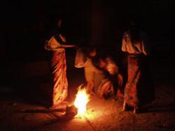 Ladies round a bonfire