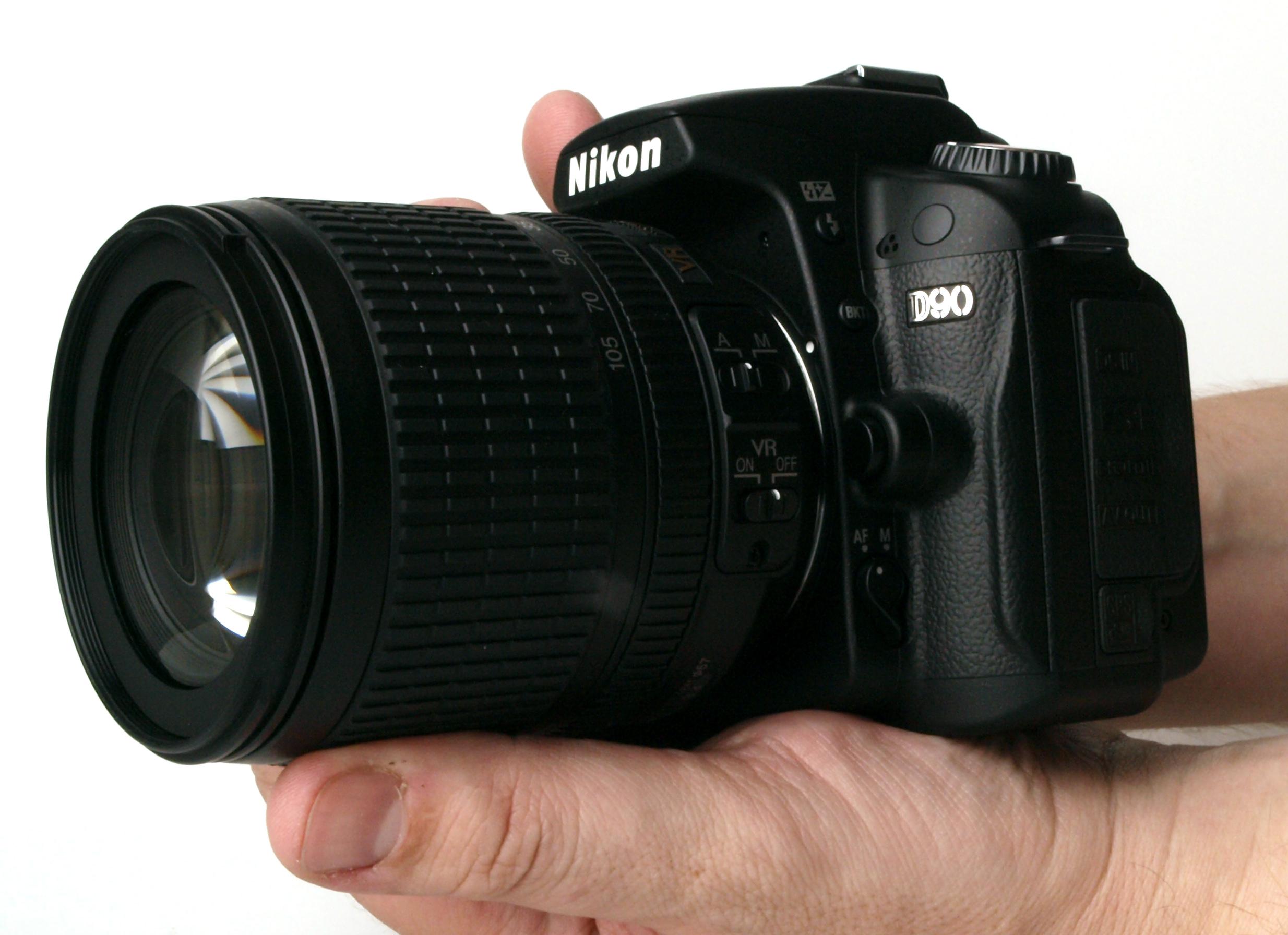 Nikon D90 held