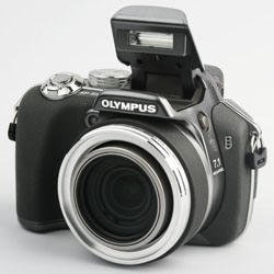 Olympus SP550UZ front left