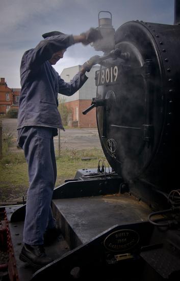 staff preparing engine for journey
