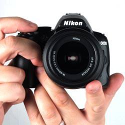 Nikon D3000 held
