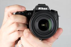 Nikon D90 held out