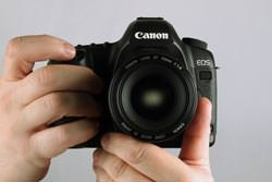 Canon EOS 5D MkII held out