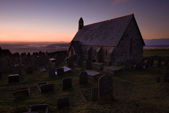 Sunset on the hillside at the small chapel at Llandecwyn, Snowdonia, Wales, UK.