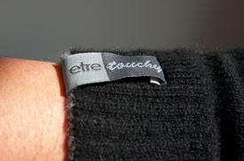 etre touchy glove label