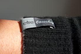 etre touchy glove label
