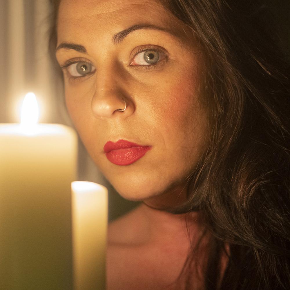 Candlelight portrait of Jessie Jayne, taken at The Boardroom studio in Derby.