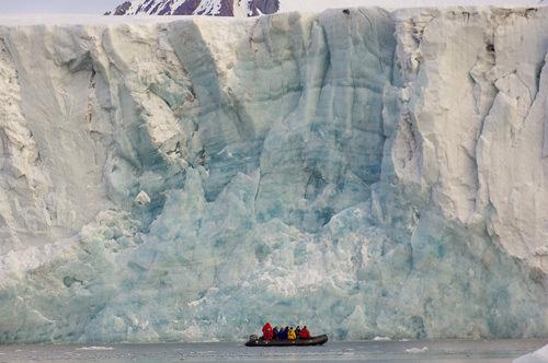 Boat infront of a glacier