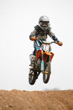 Single motorcross rider jump