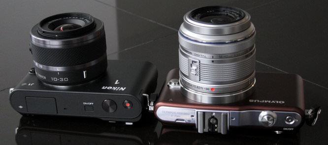 Nikon 1 J1 and Olympus PEN Mini E-PM1 Lens collapsed
