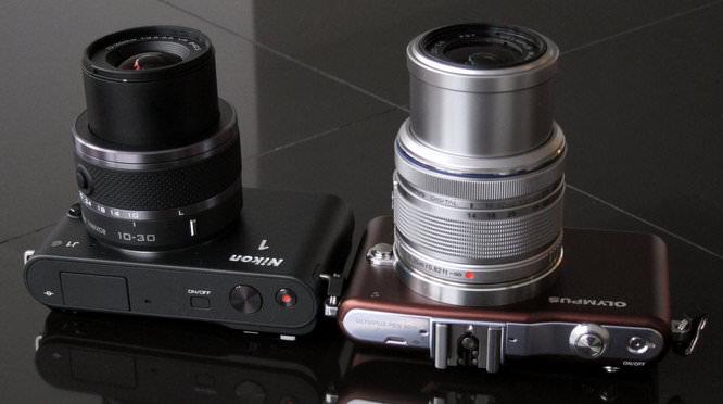 Nikon 1 J1 and Olympus PEN Mini E-PM1 Lens extended