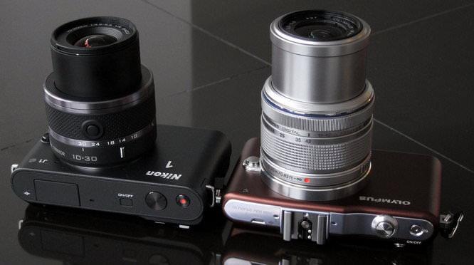 Nikon 1 J1 and Olympus PEN Mini E-PM1 Lens extended, full telephoto