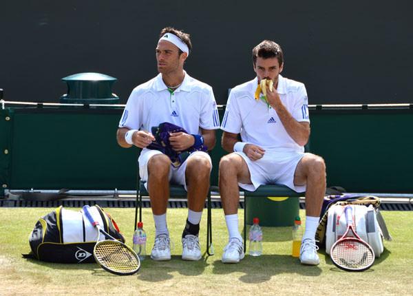 Tennis players taking a break