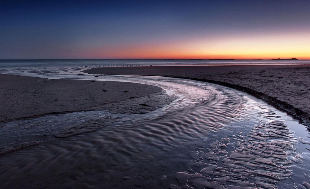 Northumberland Seascape Landscape and travel Bamburgh beach Dawn sunrise