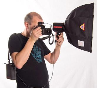 Photoflex TritonFlash being used hand held