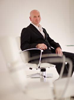 Man sat in a chair to create a sense of environment
