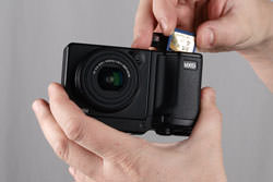 Ricoh GXR inserting the card