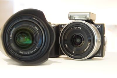 Sony NEX-5 & NEX-3 fitted with the 16mm pancake and the 18-55mm to the side.