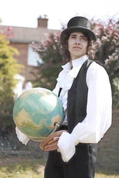 boy wiht globe