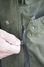 Large lower pocket features zips to give more room