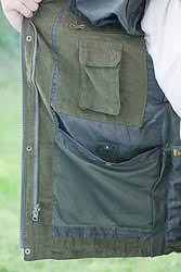 The pocket to store the hood in on the EPS jacket