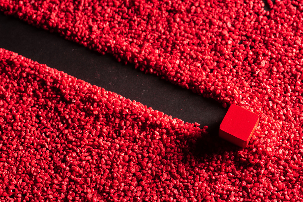 Red sand and a red block abstract photo