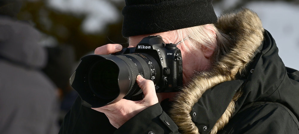 Photographer with Nikon D780 DSLR