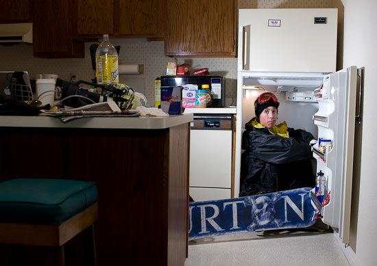 portrait of snowboarder sat in fridge
