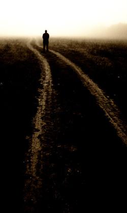 Photo by Jon Mcgovern showing a man walking down a path