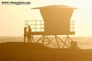 Couple About to Share a Romantic Kiss Next to Lifeguard Tower at Huntington State Beach, Huntington Beach, California