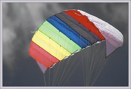 A kite makes a colorful sky. by tebo