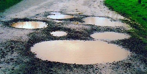 Muddy puddles by debbie