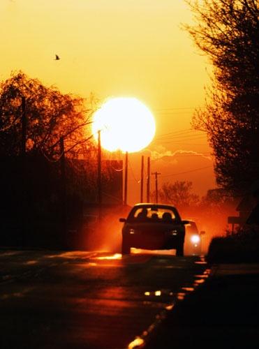 Sunset after heavy rain by david j. green