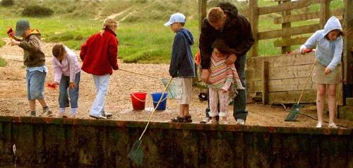 crabbing at walberswick by john p