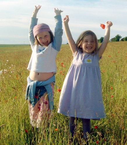 Poppy Poppets by hedge