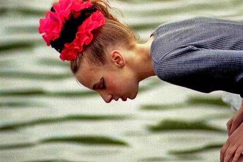 Girl looking into lake by victorburnside