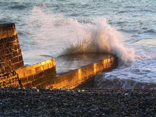 Pier Wave at Sunset by john ballance