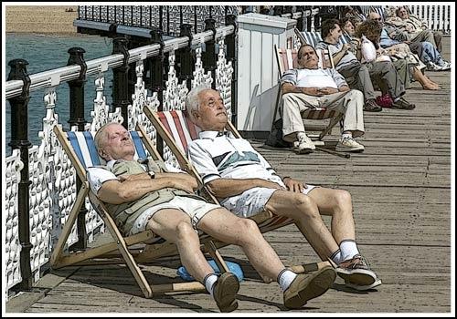 Sun Bathing: Brighton Pier by john ballance