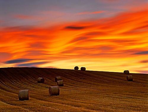 Haybale sunset by hwatt