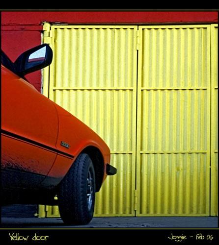 Yellow door by joggievs