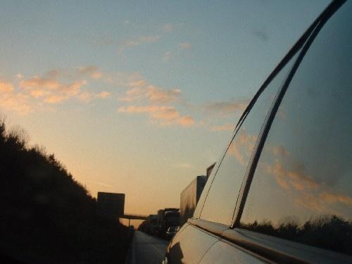 Sun setting on motorway by ktish