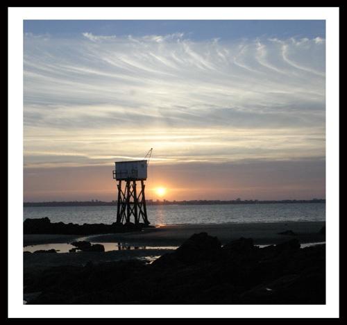 Fishing hut and sunset by Meg