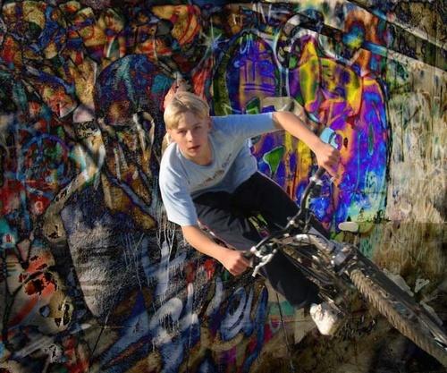 Boy on concret Wall by YvonneKTurner