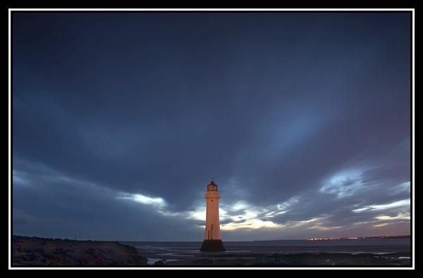 Basking Lighthouse by Anthony