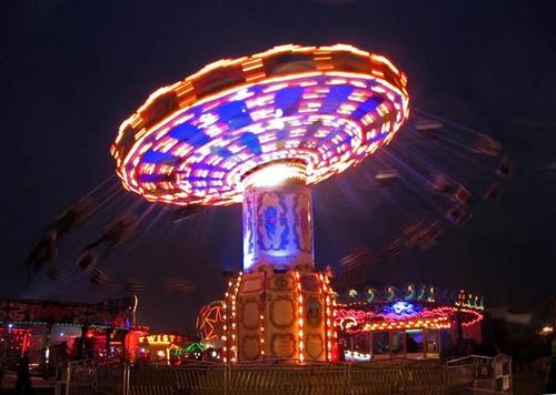 fairground at night by bigbrum