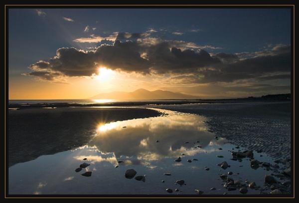 Sunset on the beach by mathugamble