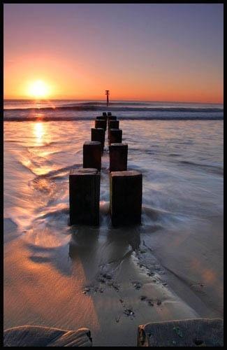 Sunrise over the groynes by Gaz_H